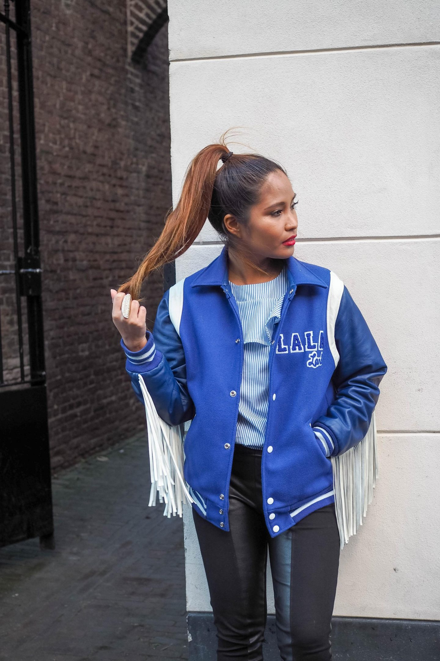 Blue baseball jacket with fringes and striped top