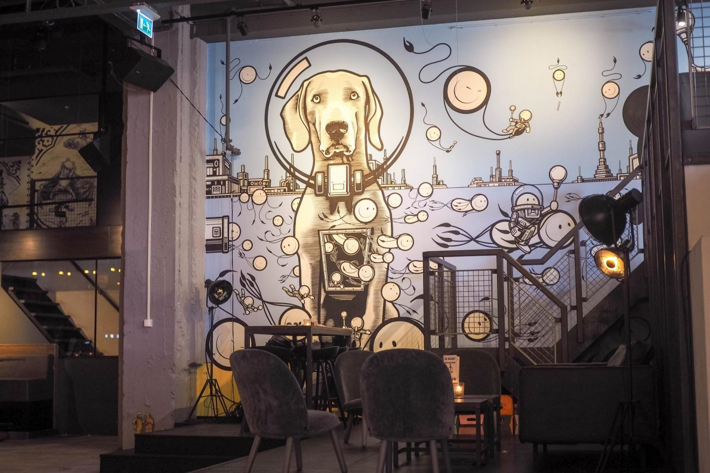 Admire the delicious food and street art interior of the Bar and Bikkesement De Bajes